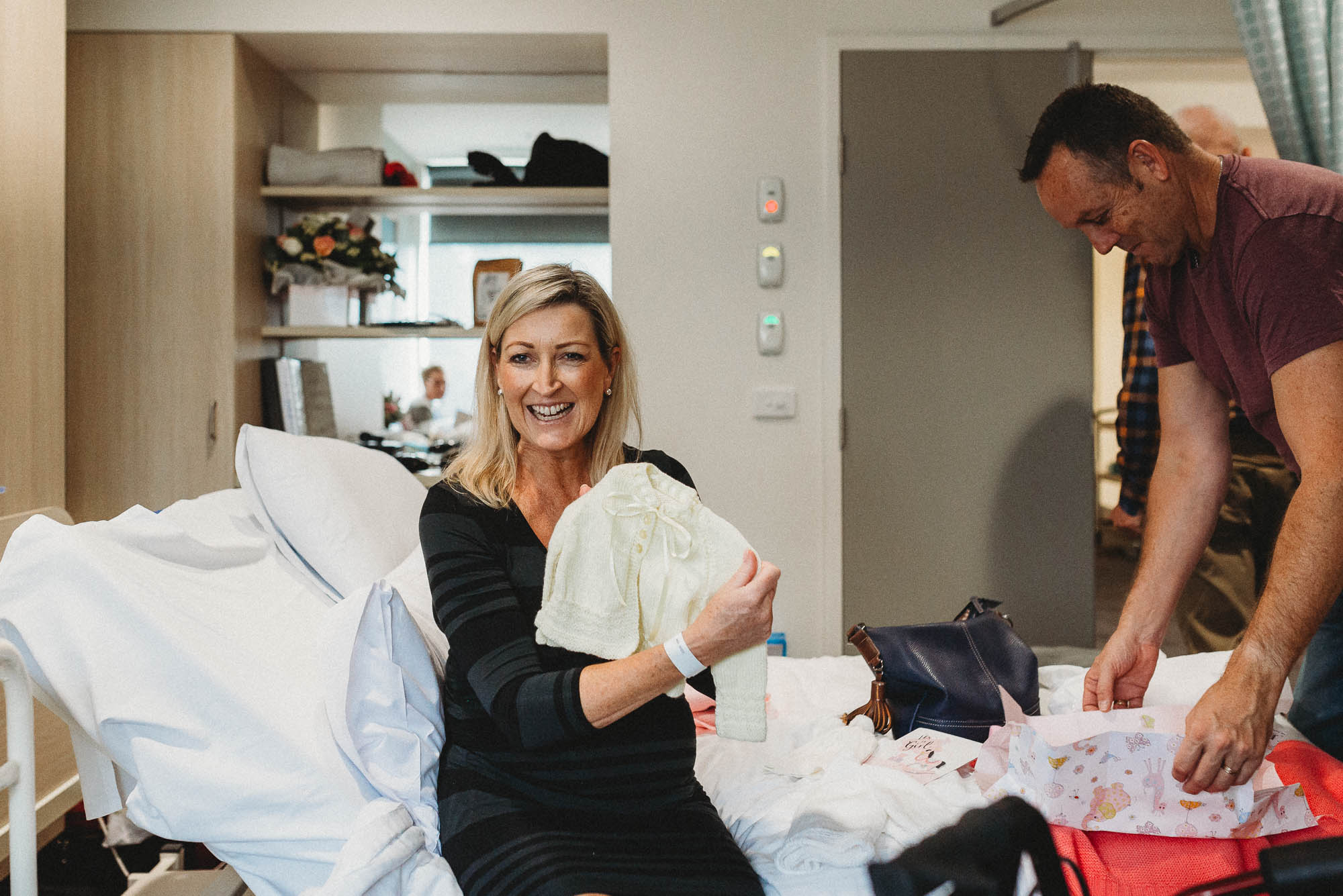 mum-opening-baby-gifts-in-hospital-melbourne