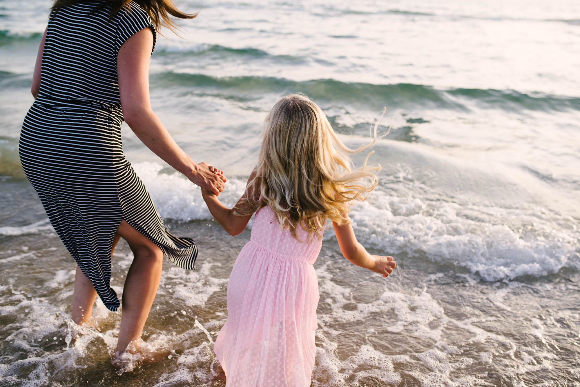 mum_holding_hands_and_playing_with_daughter_at_the_beach_melbourne_family_photographer-1.jpg