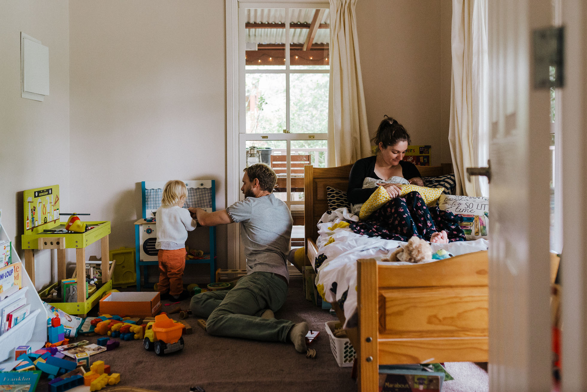 melbourne-family-photographer-family-playing-together-in-child's-bedroom.jpg
