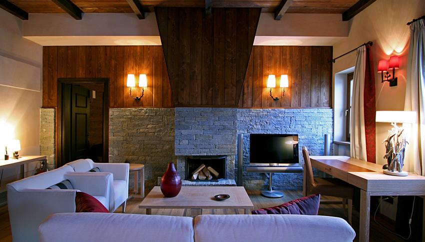 Guest Suite Lounge with Stone Fireplace & wood panelling