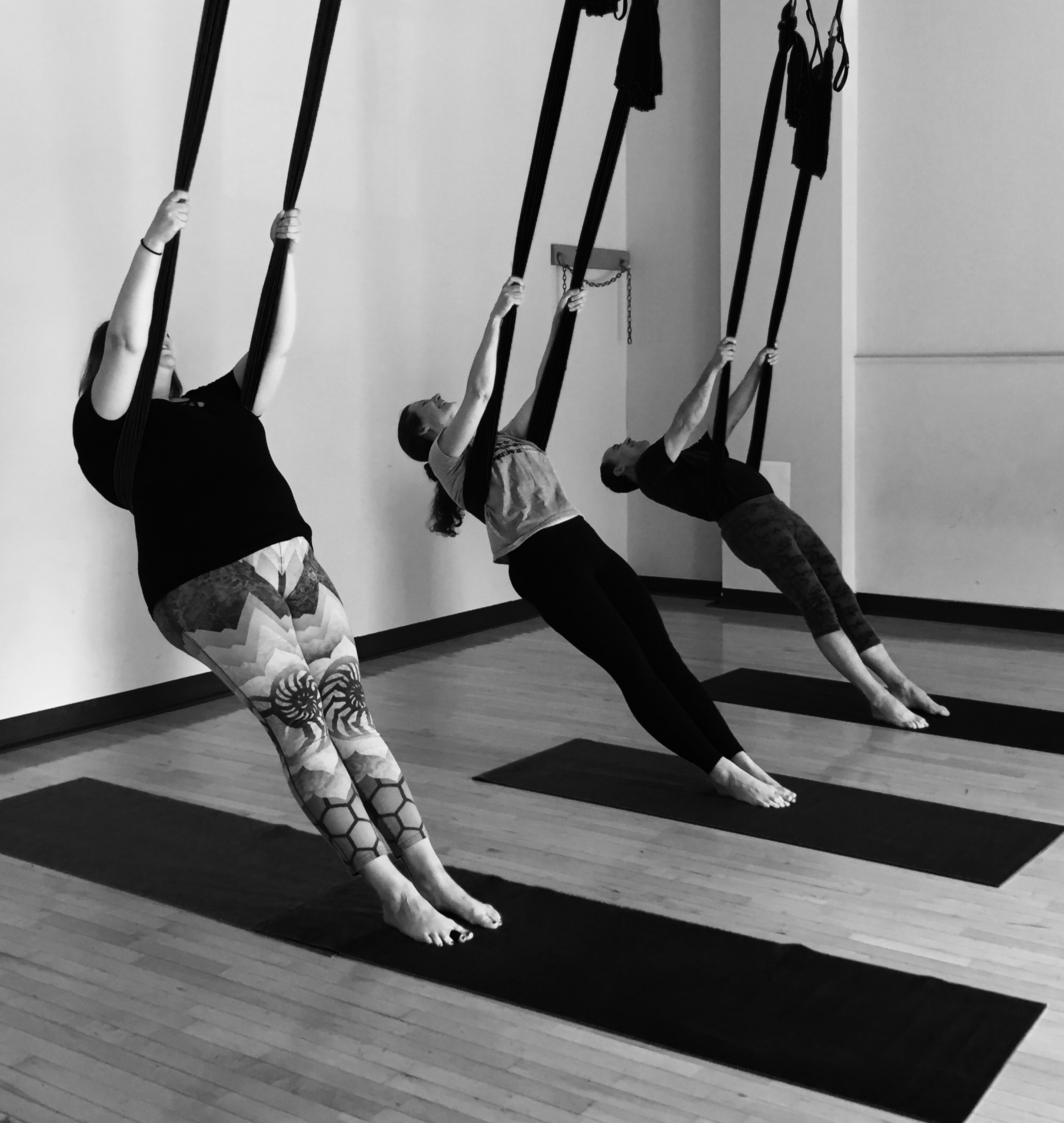 Beginners and experienced alike can benefit from the release of aerial yoga.