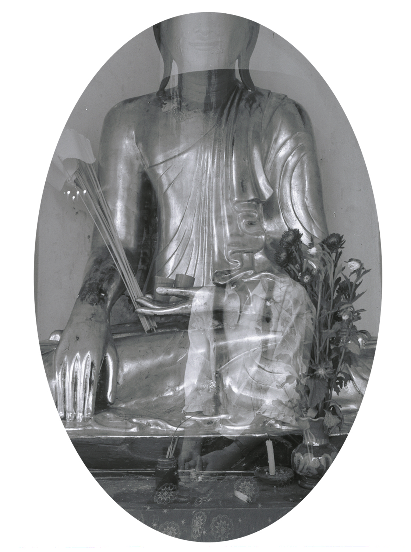 The Girl in the Buddha, Shwedagon Pagoda, Rangoon, 2005