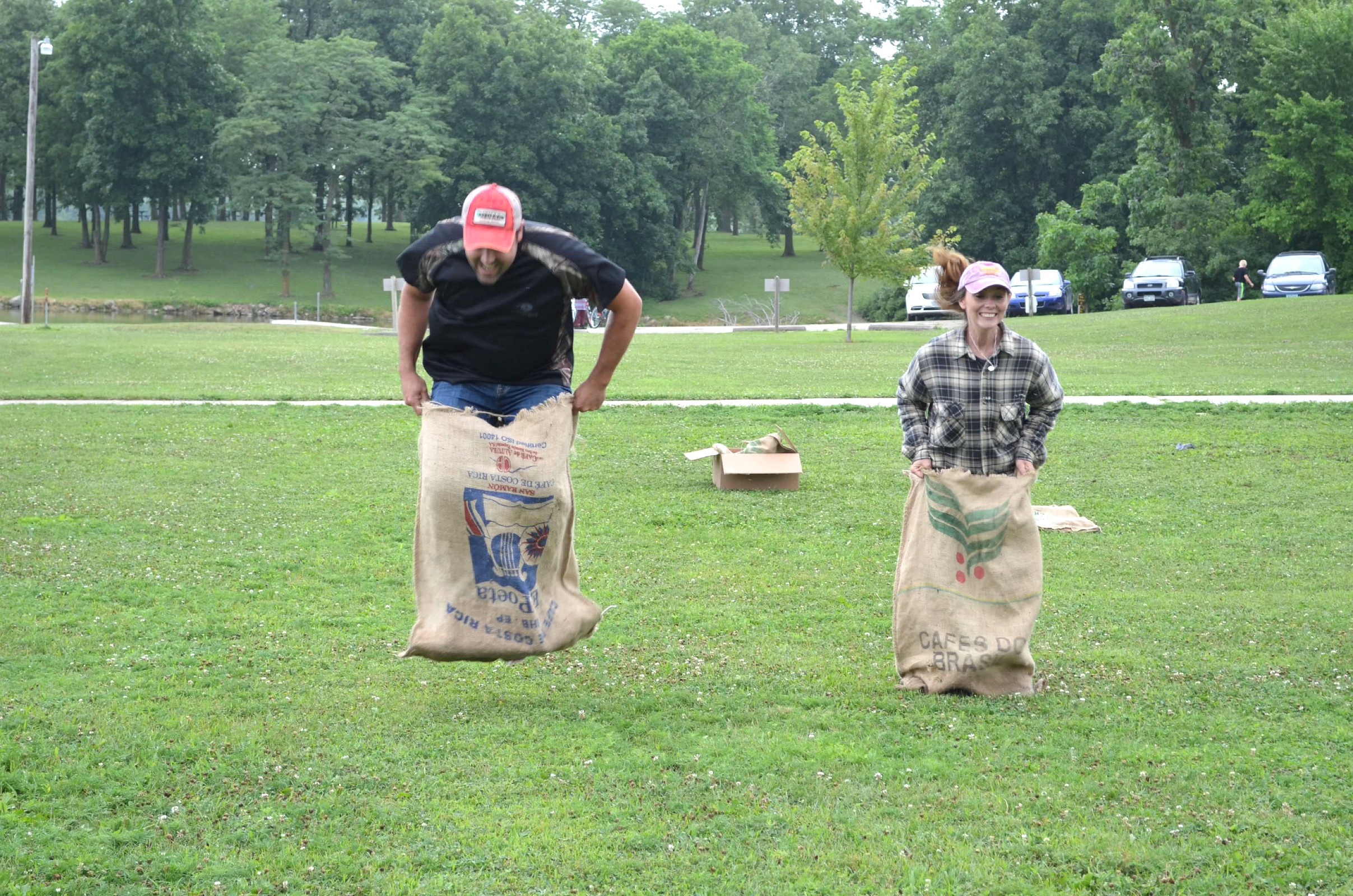Zeb and I enter a gunnysack race at the Lake of Three Fires... obviously he beat me! (I let him win.) :)