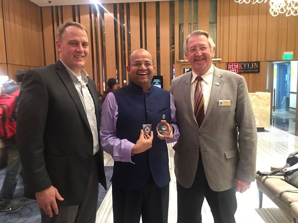 Lt. Evenson and Mayor Brede presenting   community Medal of Honor to From India With Love initiative