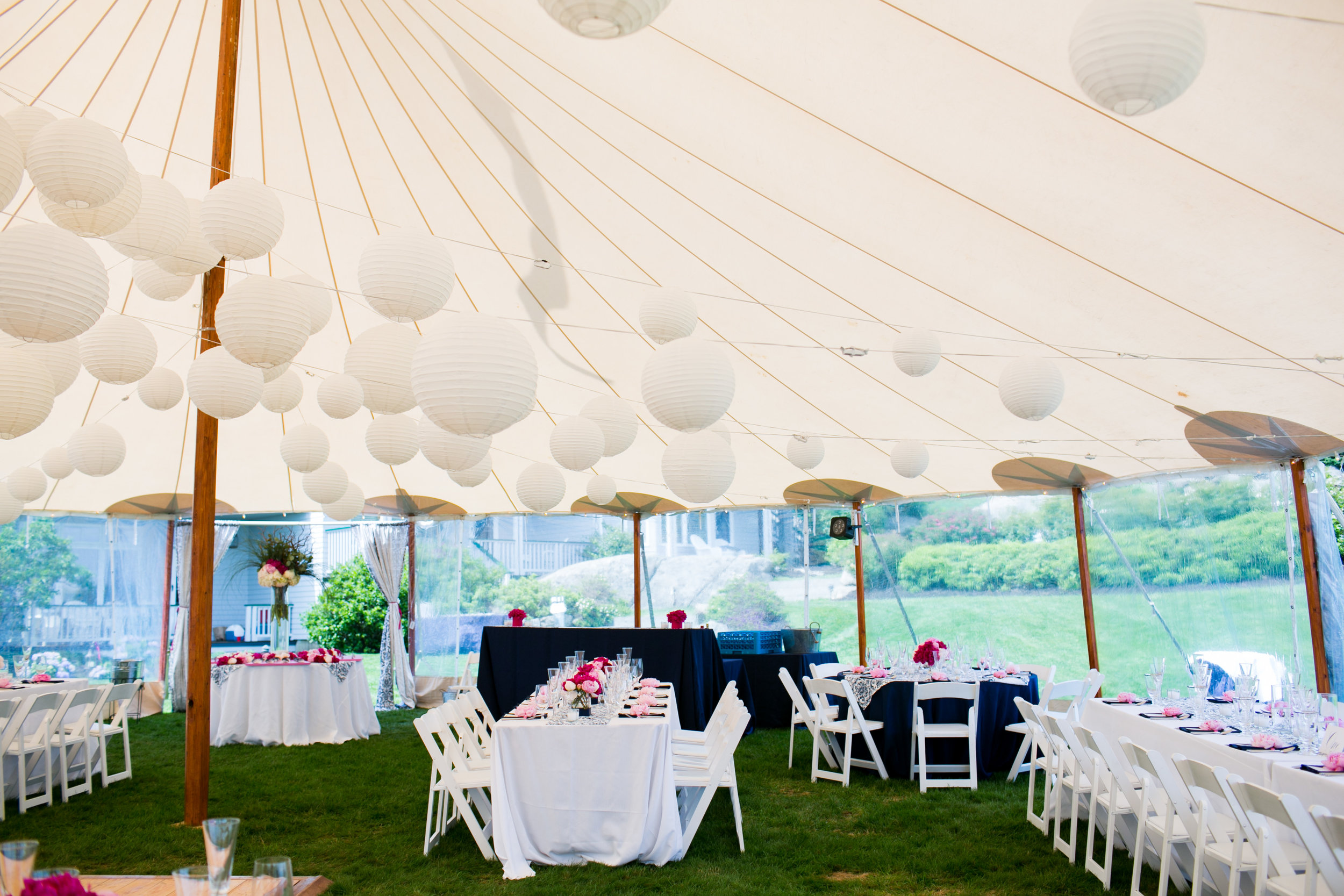 A traditional ocean side tented wedding at the  ViewPoint Hotel  in Maine. Image by  Mark Davidson Photography .