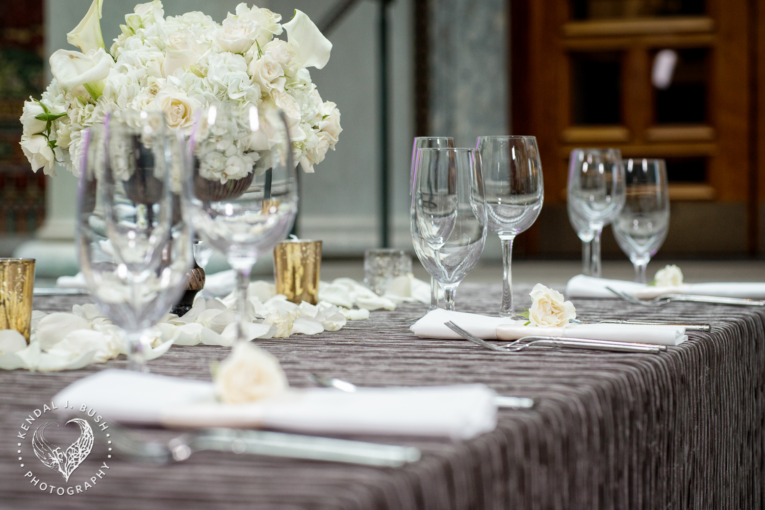 Featured level two, Illustration with taupe Romance linen, and fresh vendela rose petals down the center of the table. Image by Kendal J. Bush Photography.