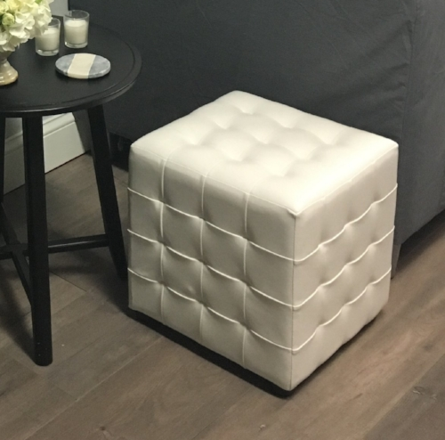 White square leather accent table.