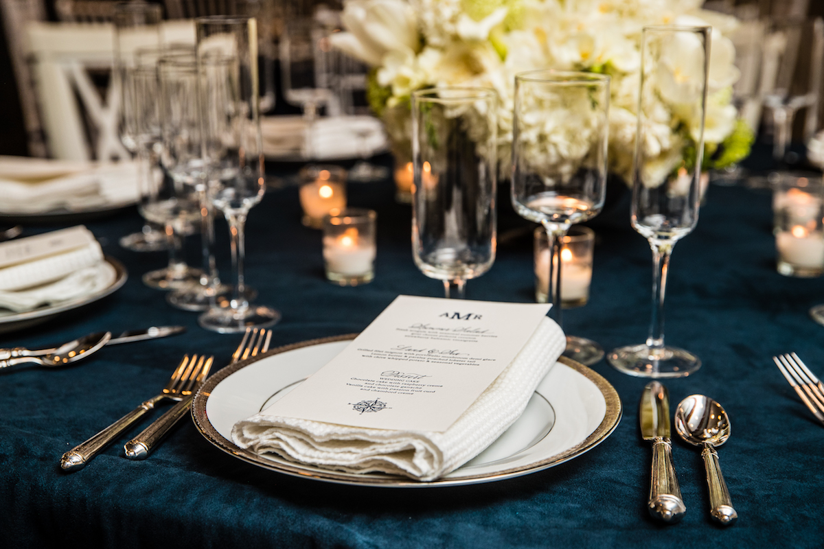 A detail shot of the third package, Ocean. Custom letter pressed menus in navy ink are featured on white waffle napkins. Image by  Eric McCallister Photography .