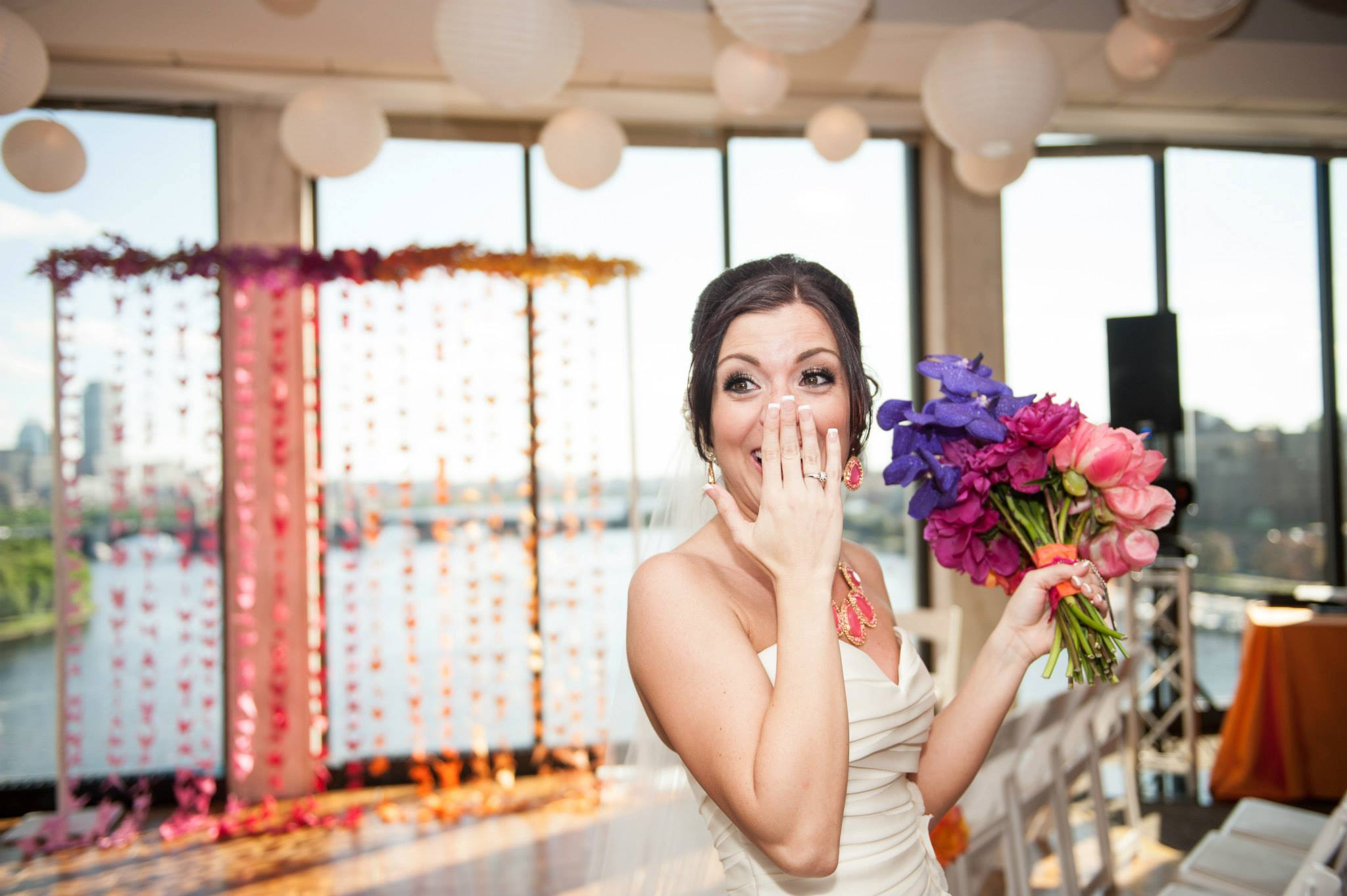 Custom ombre 1000 paper crane ceremony backdrop overlooking the Boston skyline. Image by Todd Ward.