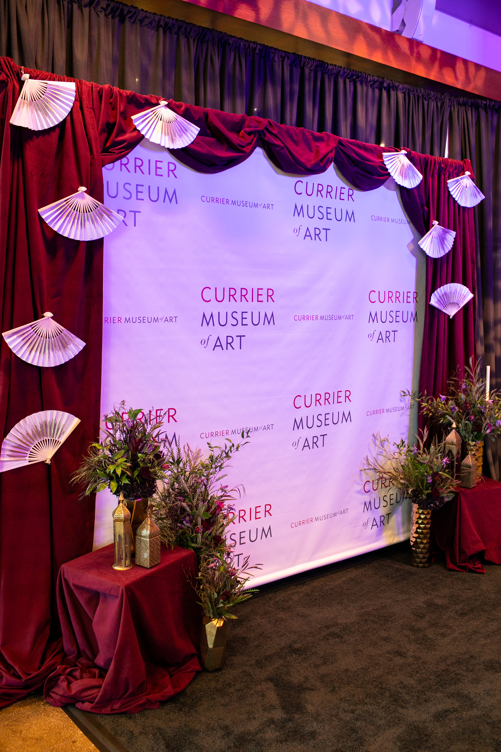 Masquerade_Ball_Currier_Museum_Manchester_Malloy_Events_branding_drape_floral_staging