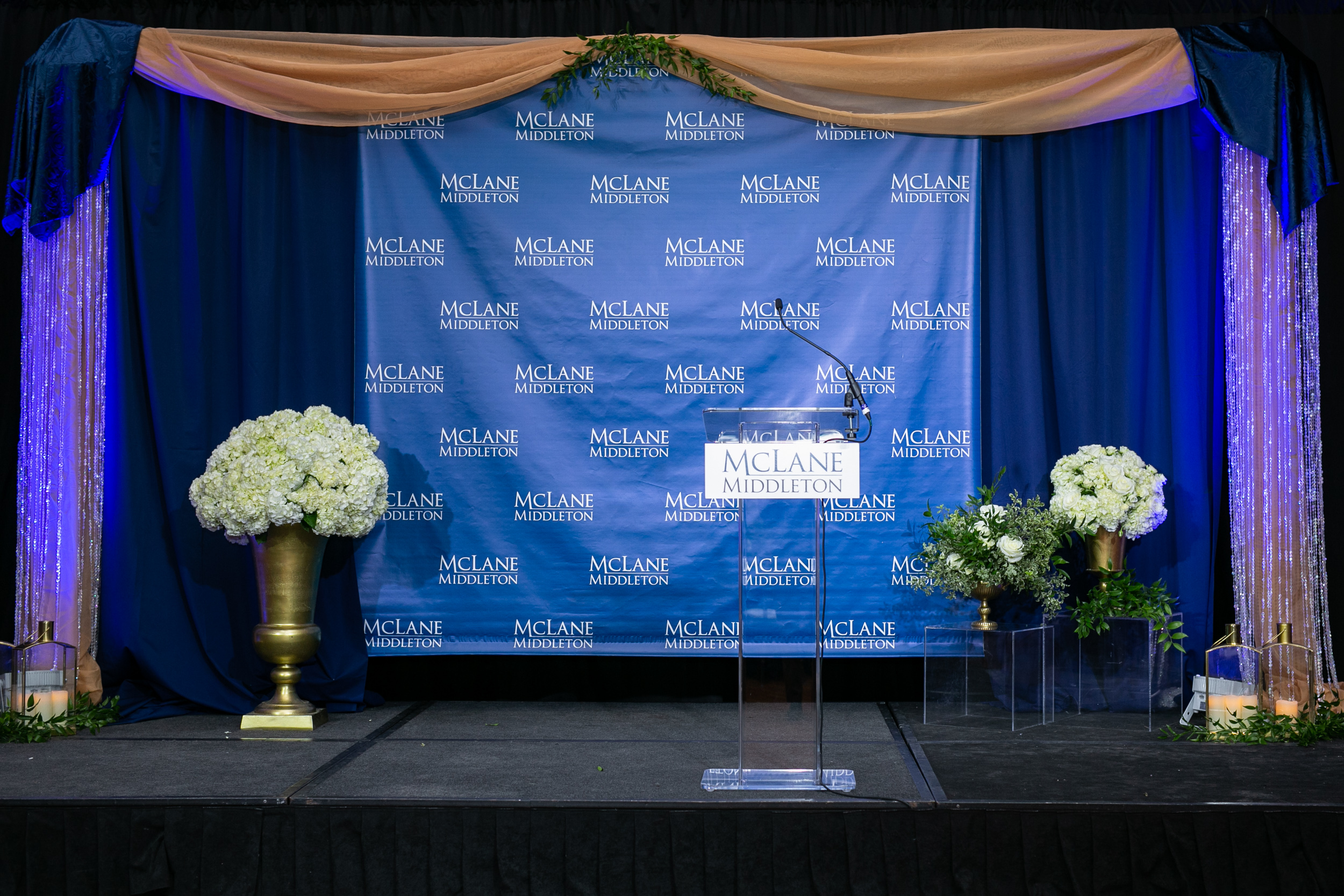 Malloy_Events_Pizzuti_McLane_Middleton_Centennial_Celebration_Manchester_NH_Corporate_Production_stage_drape_floral_stagepiece