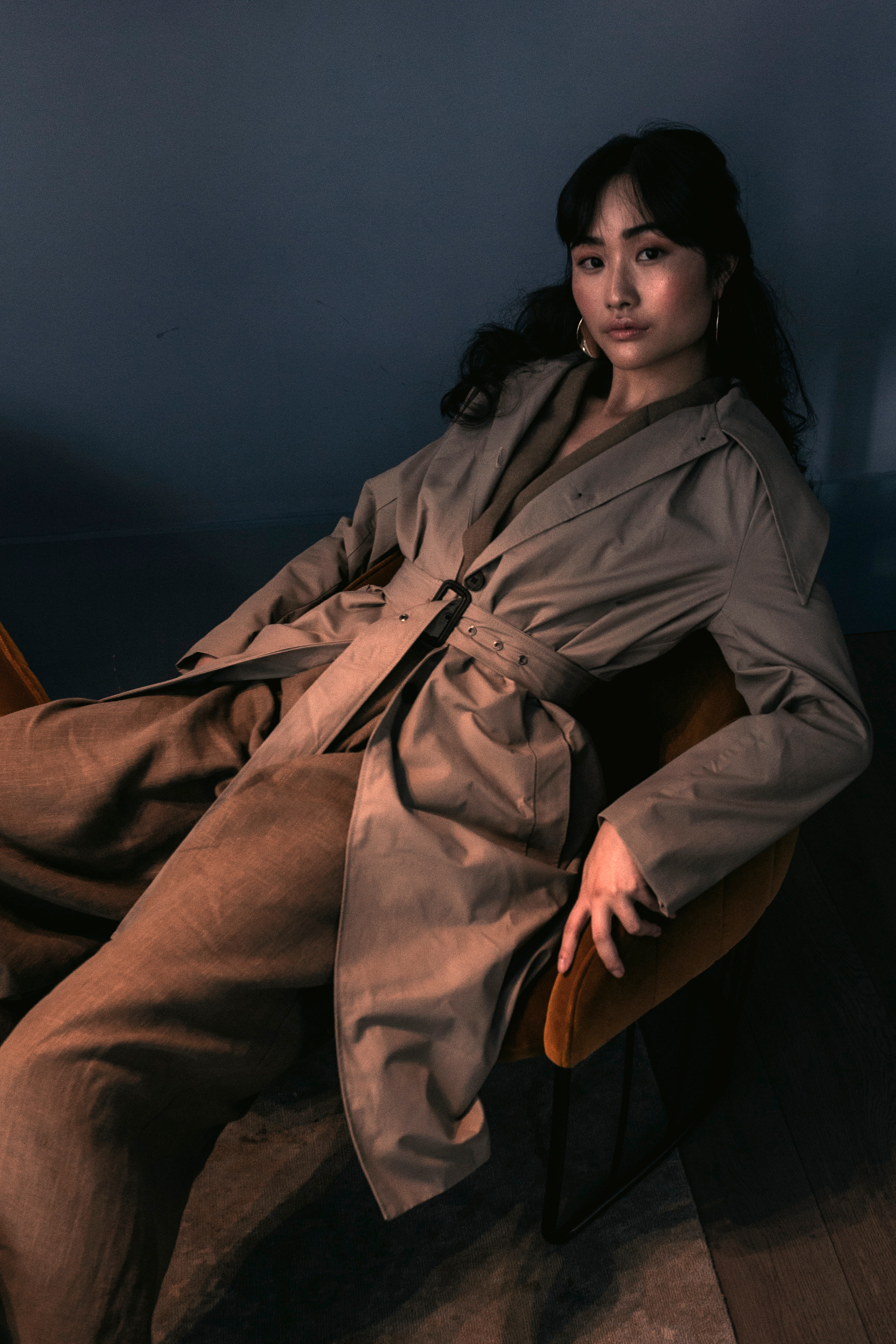 Jumpsuit: Linen Brown Jumpsuit  The Frankie Shop  Shoes: Thrifted Stylist Own Earrings: Topshop Stylist Own Coat: Pointy collar beige trench from  The Frankie Shop