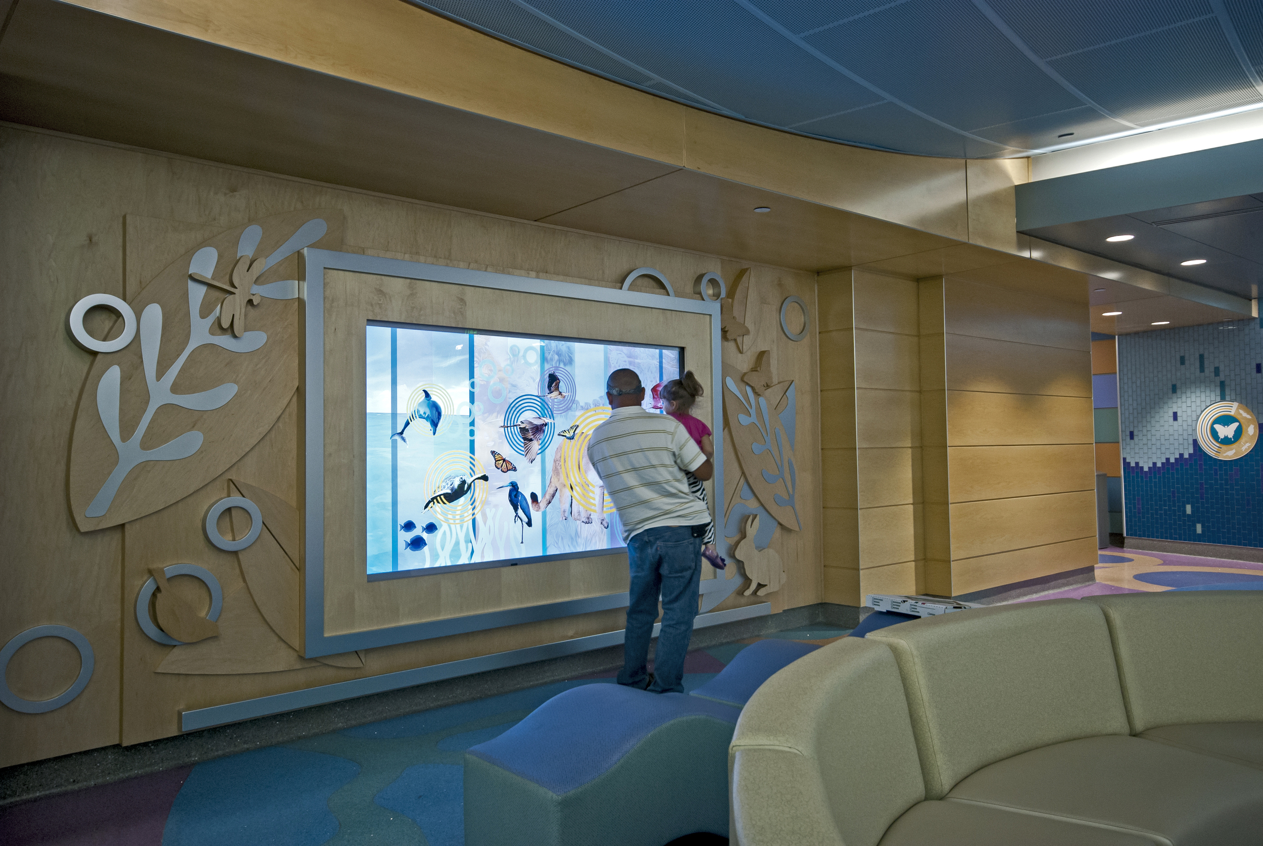 Interactive wall with man and daughter playing game.jpg