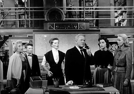 Desk Set (1957). Expert operators at a TV network's research department must adapt to new technology. Fabulous movie.