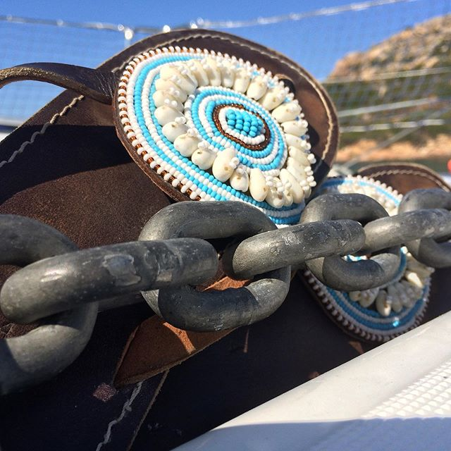 The road to happiness. Or the boat to happiness or flight to happiness. Where your summer adventures take you, pack your Wazis! Wazi means open in Swahili, open road, open heart, open mind. #summeradventures #sandals #handbeaded #whattobuy #shopsmall #shopsmart #tanzania #seashells #turquoise #sandpiper #sardinia #openroad #openheart #openmind #giveback #leathershoes #ecocloset #slowfashion