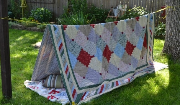 Here's a picture tutorial  for building this easy tent fort.