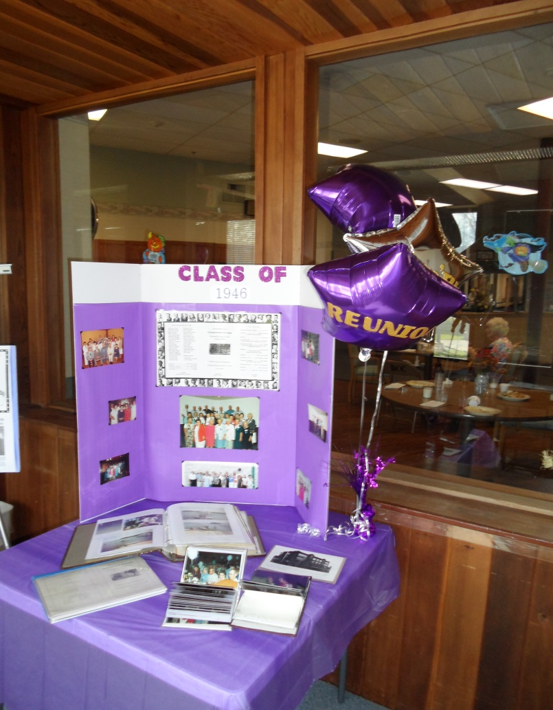 A display table of photos at the class of 1946 reunion sparked many memories!