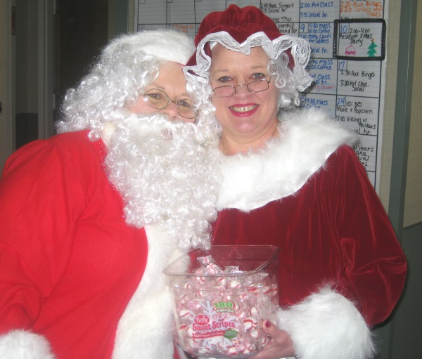 Santa and Mrs. Claus stopped to take a photo
