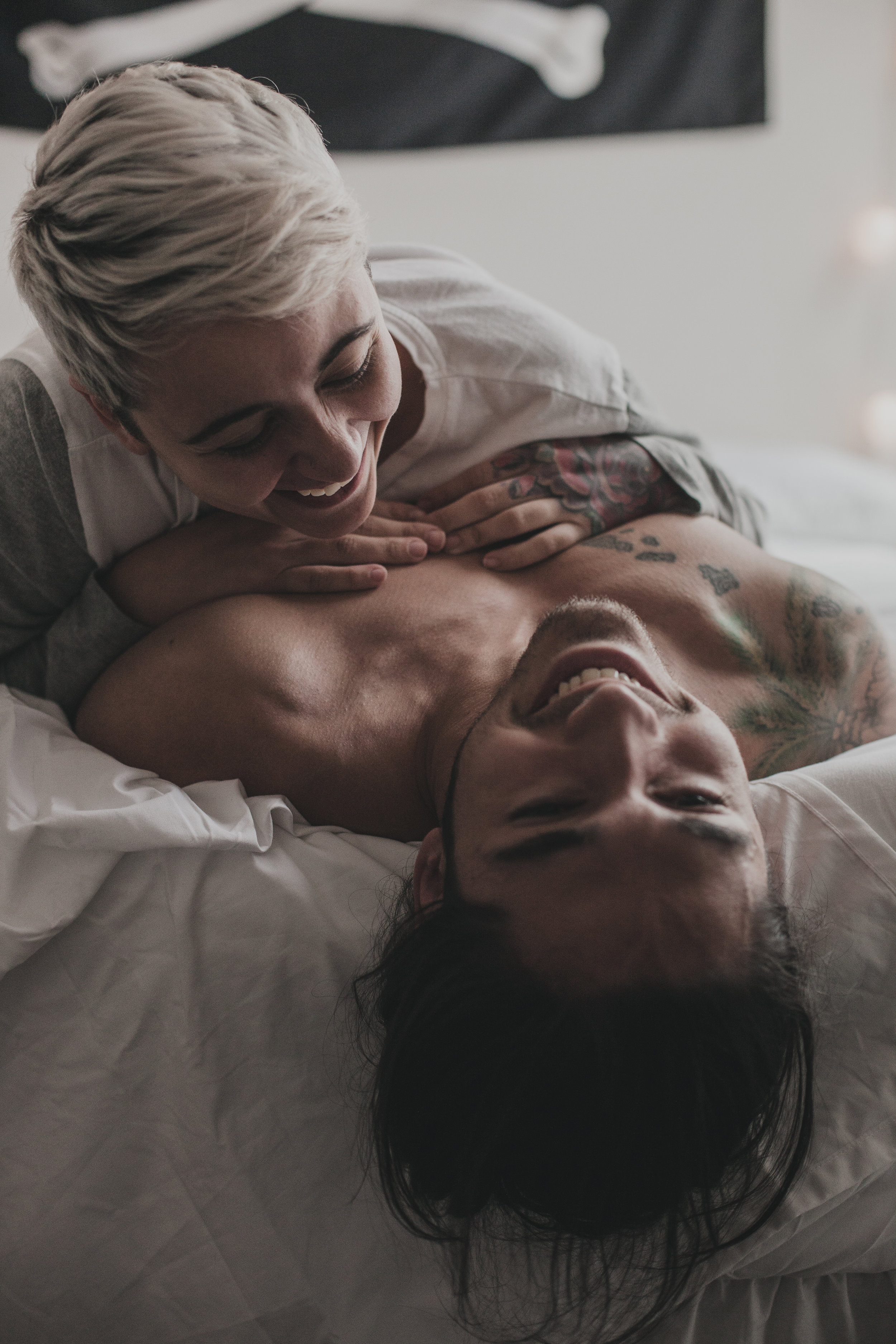 © duston-lifestyle-couple-laughing-bed.jpg