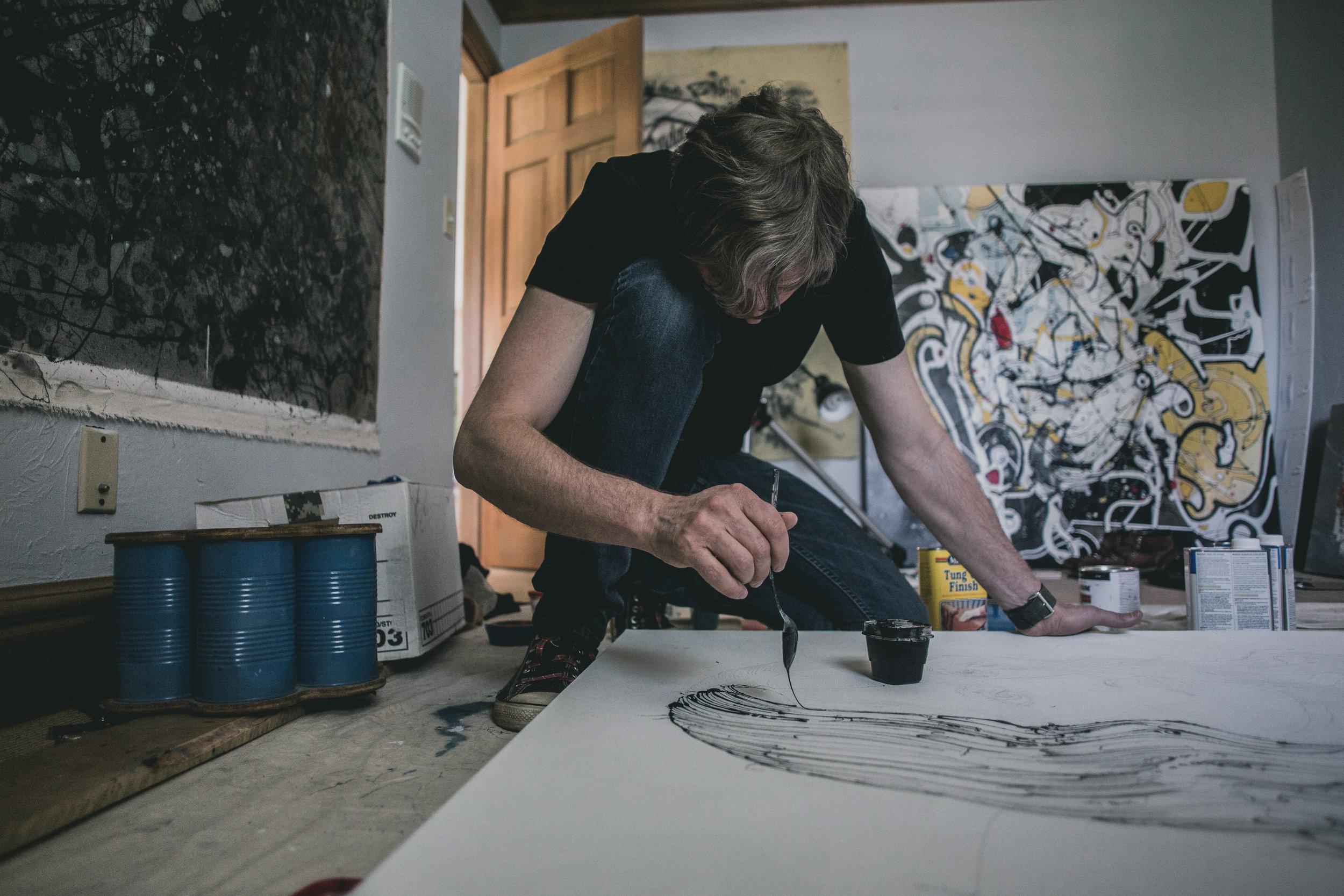 © duston-todd-portrait-artist-painter-working.jpg