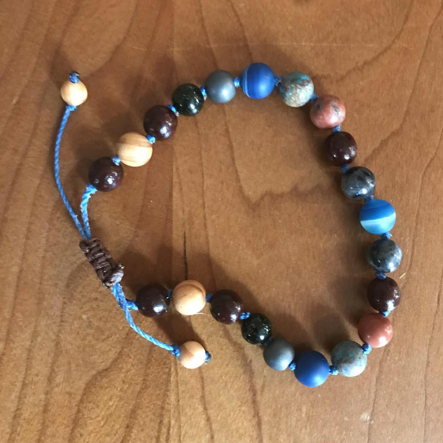 Mala Bracelets - This beautiful bracelet is made of sandalwood, labradorite, green gold speck, hematite, blue stripe agate, red picasso jasper, and sea sediment jasper.   $45 USD.