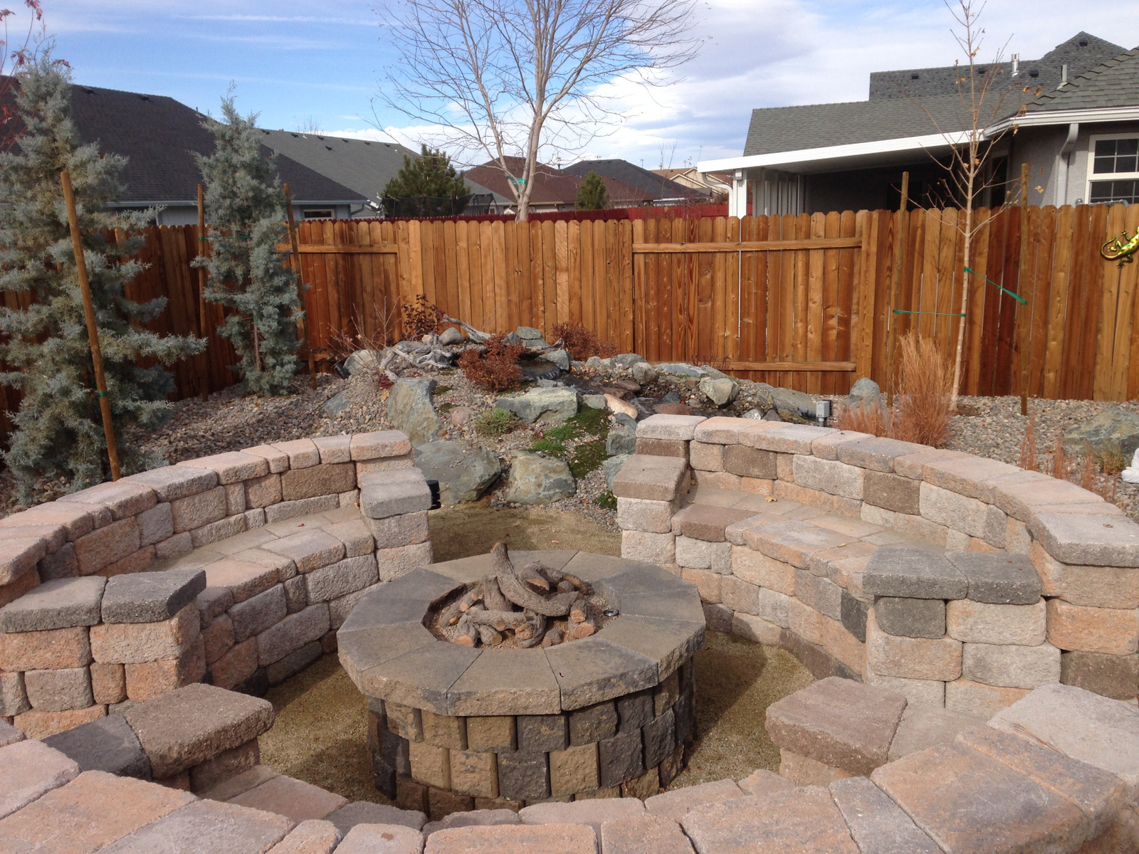 A built-in gas fire pit with bench seating for six.