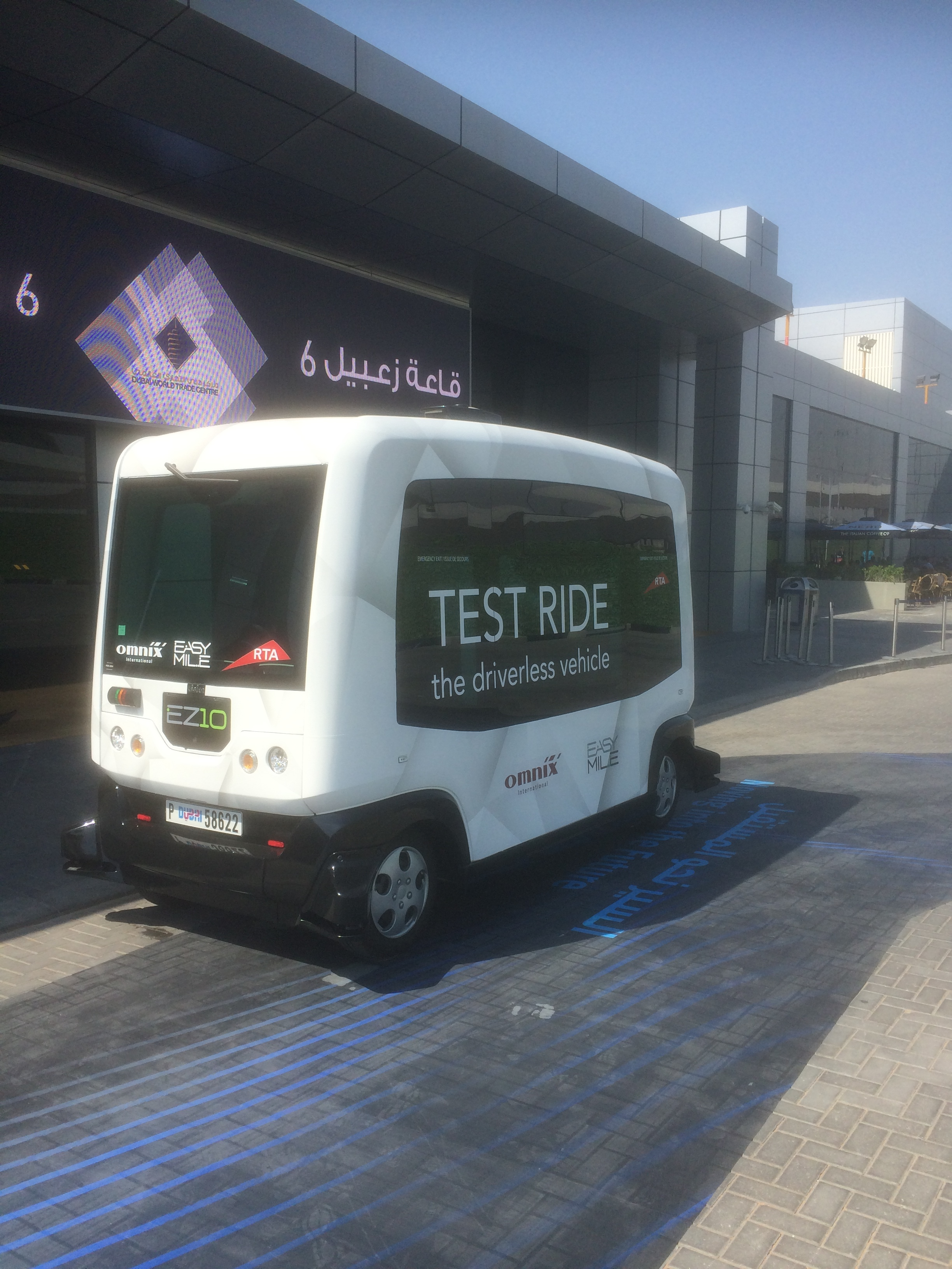 Driverless minibus on display and test running outside UITP's MENA Transport event in Dubai at the end of April