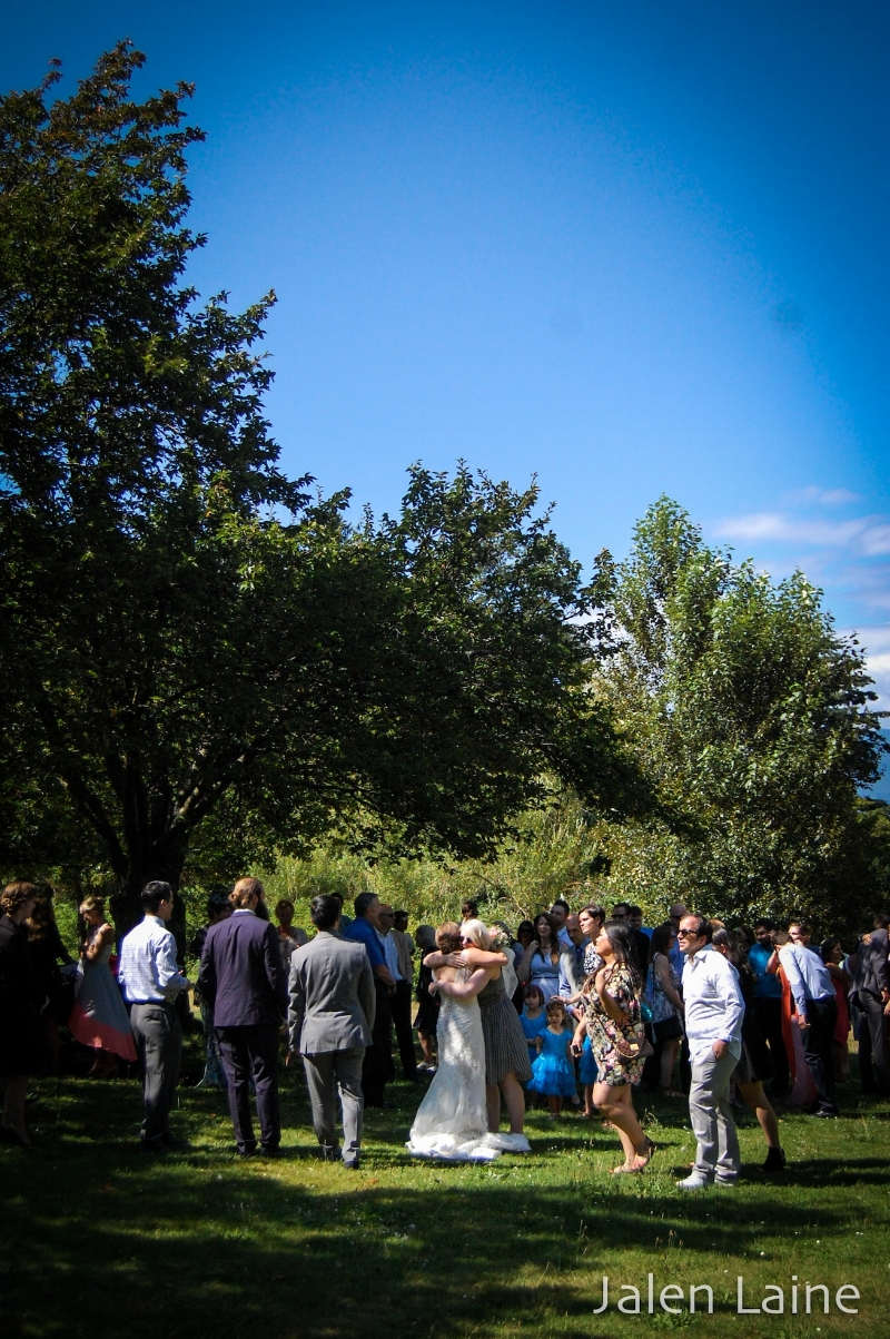 At the end of the ceremony, M&K greeted each and every guest under the shade of some nearby trees.