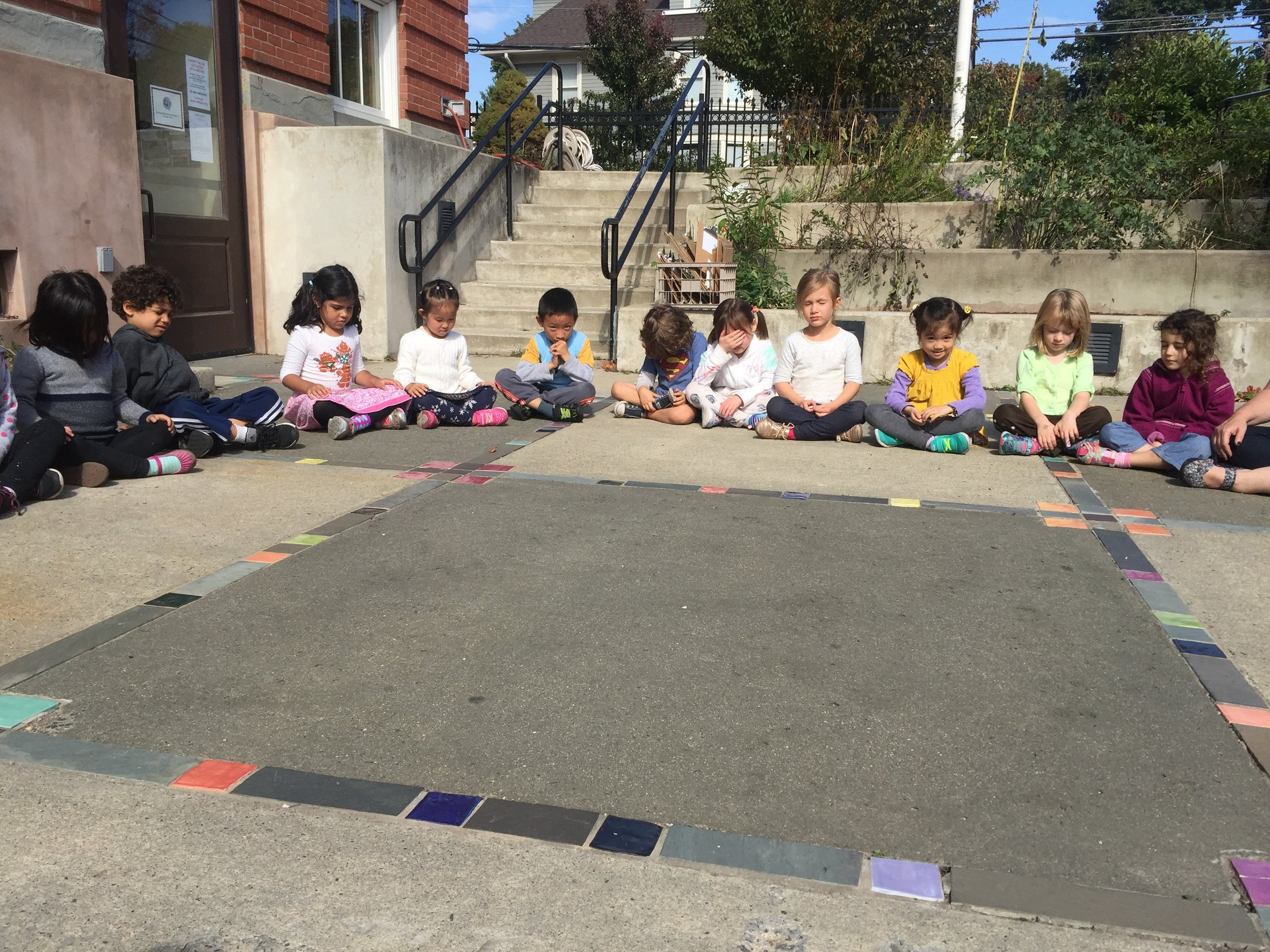 Mindful Listening in the courtyard