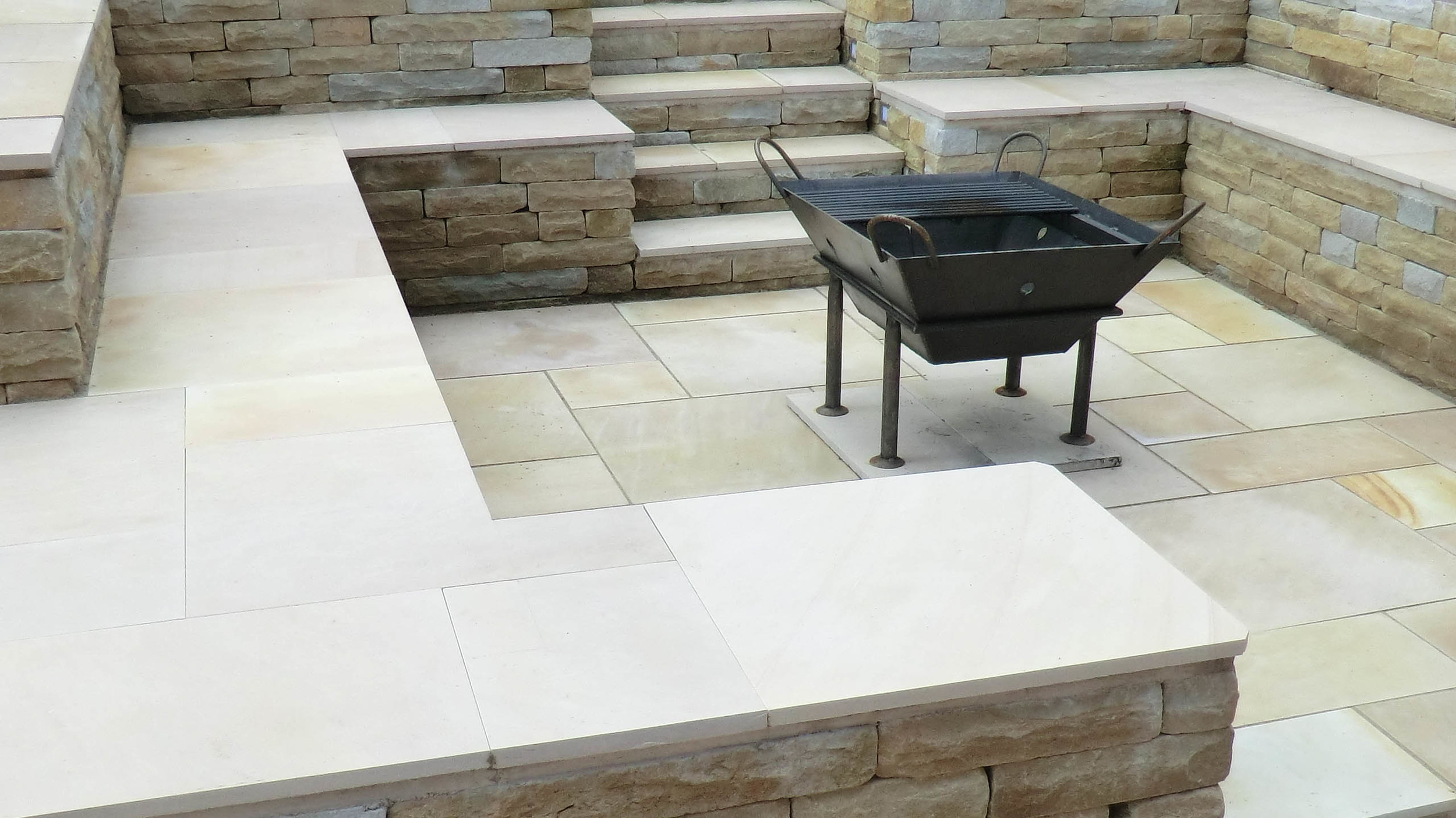 Cheshire Garden Design: Sawn Stone Seating Area With Fire Pit.