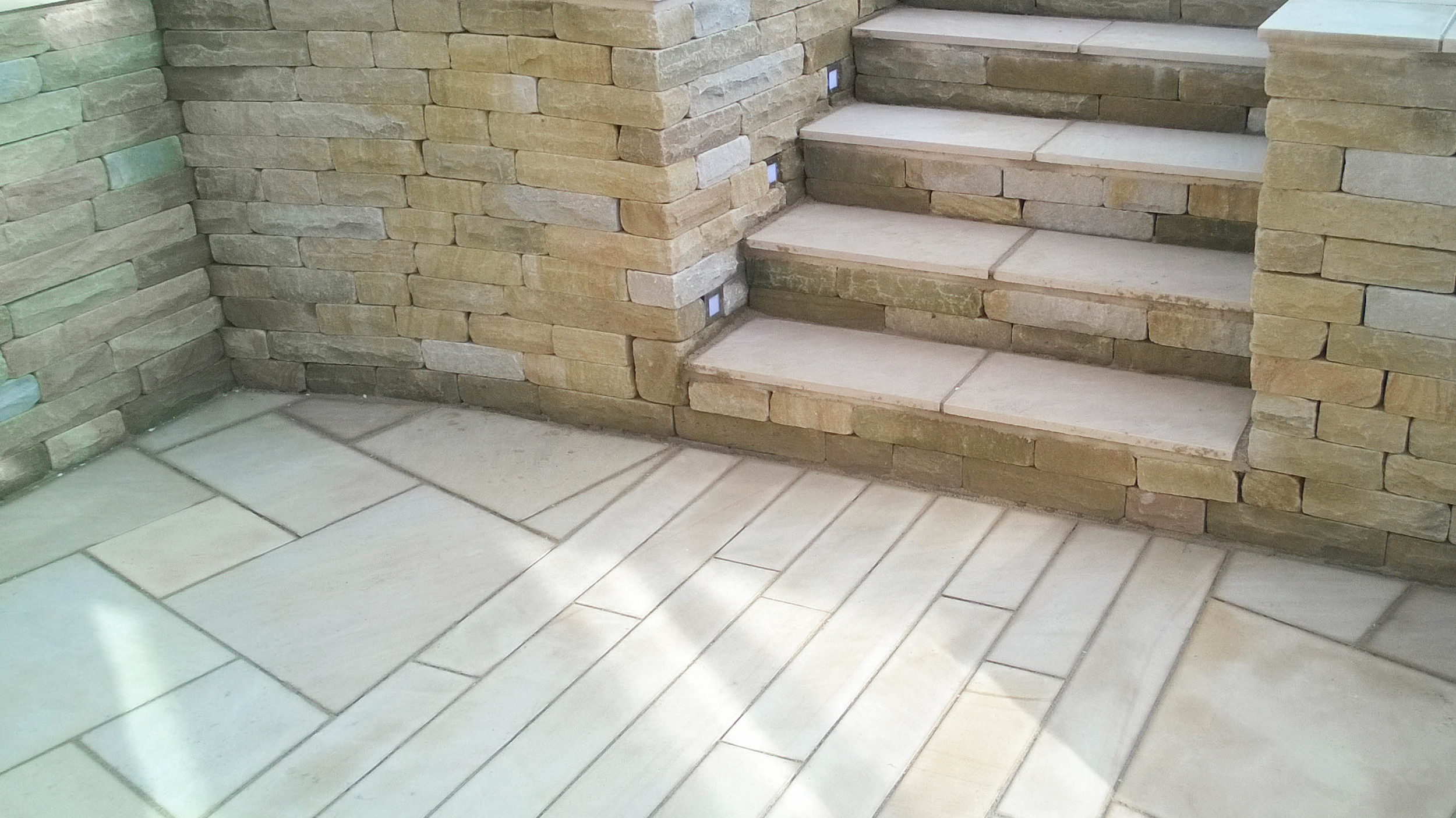 Cheshire Garden Design: Sawn Stone Steps with dressed stone wall.