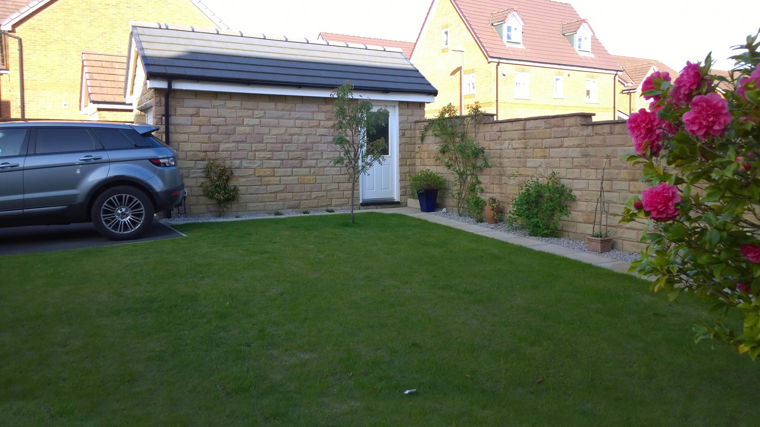 BEFORE - Little visual interest and poor access up to the car port causing client to walk over wet lawn.