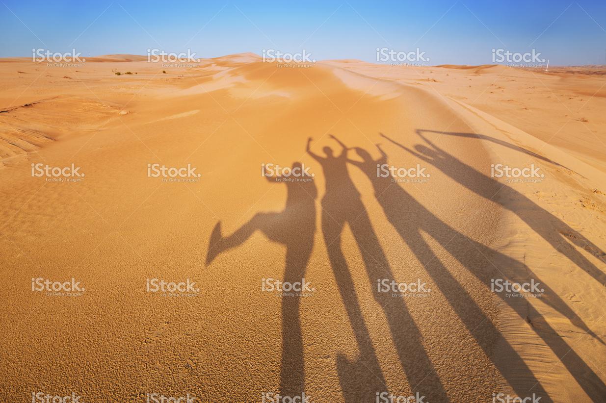 Friends having fun in the desert (Example Caption)