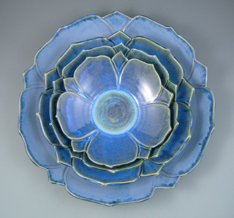 18 inch set ofstoneware columbine bowls, cut edges, blue glazes, Gail Johnston.JPG