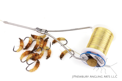 The second step often involves dubbing the body and ribbing. Where possible, use spooled materials to speed up your tying process and save on waste.