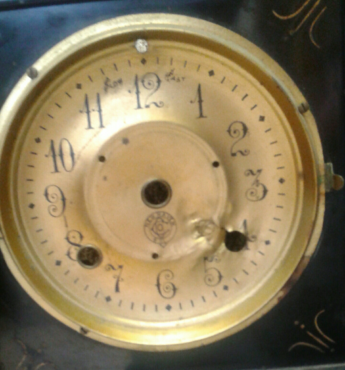 "This black mantle clock was shot with a 22 cal. . I overhauled the movement and it runs fine now . The movement had no damage at all . Like I always say ,"" You never know what you will run into in clock repair ."""