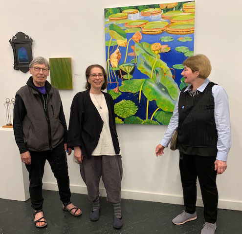 Right to Left: Barbara Sosson, Miriam Seidel, and Professor Didier at FAME 2019 at Hot-Bed Gallery; art by Sosson, Rane, Hawley, Victor