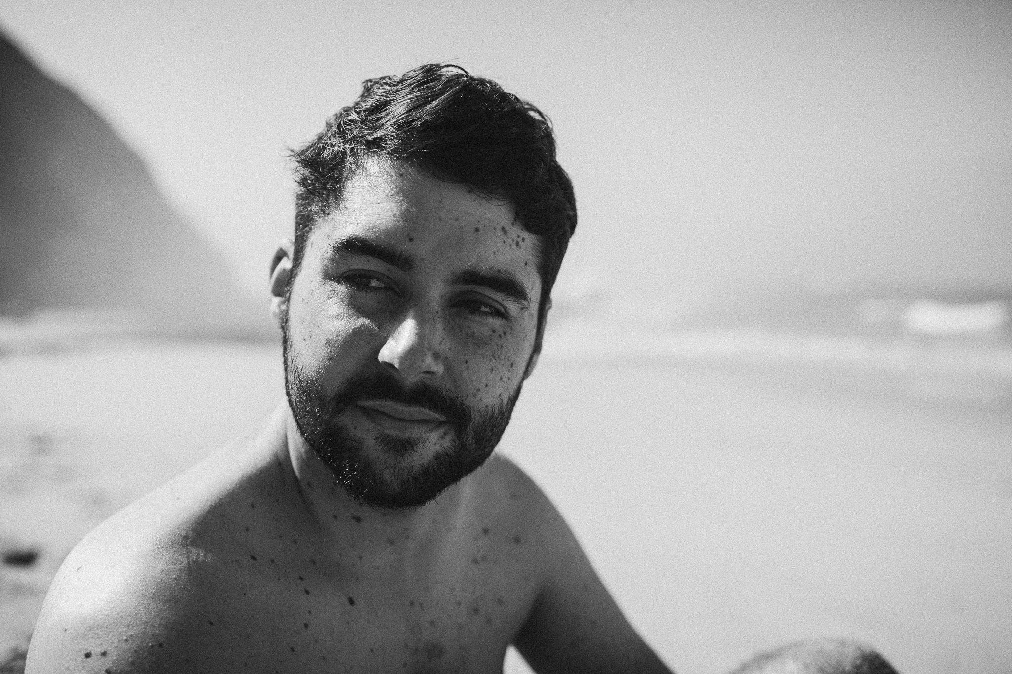 Portrait of a bearded man on the beach