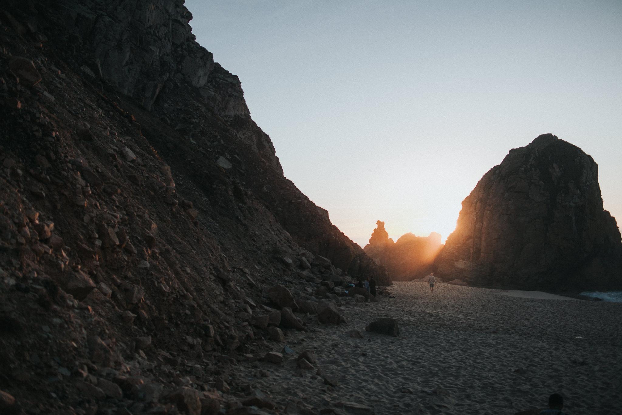 rays of sun between rocks
