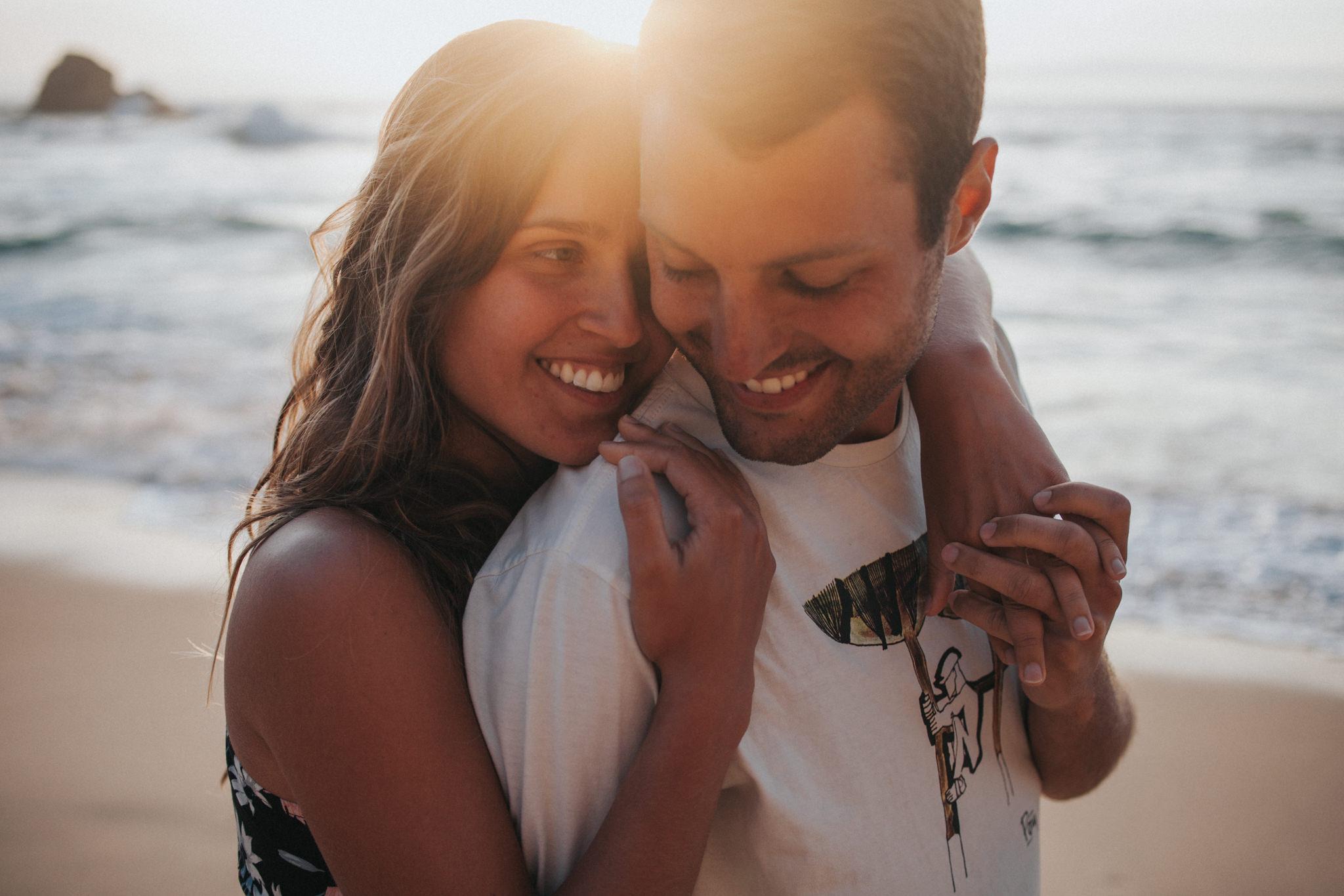 Bride and Groom smiling during the sunset at Praia da Ursa