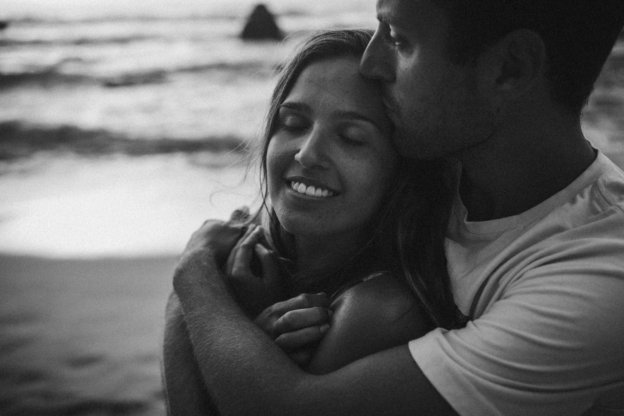 Couple hugging at a beach