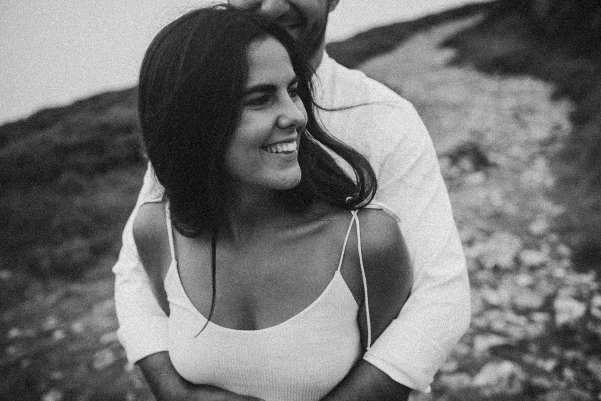 Man hugges his girlfriend