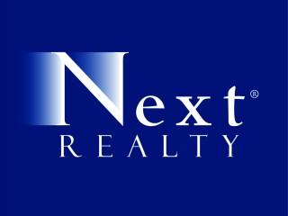 Next_Realty_logo_pms_295_rev.jpg