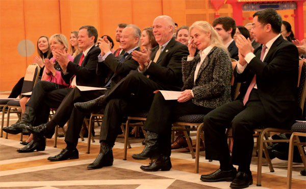 Chinese Ambassador to the US Cui Tiankai (from row, third from left), US Senator Steve Daines (second from left) and US Congressman Greg Gianforte (third from right) of Montana applaud while watching a show by the Rocky Mountain Ballet Theatre at the Chinese embassy in Washington on Monday afternoon. Chen Weihua / China Daily