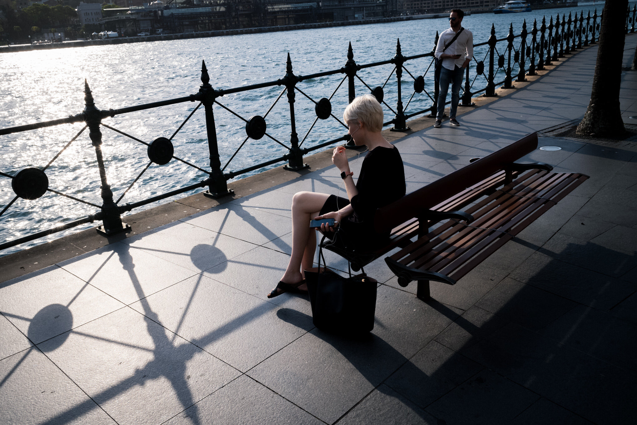 Girl on phone on bench-401.jpg