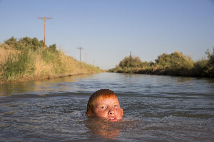 kid in river.jpeg