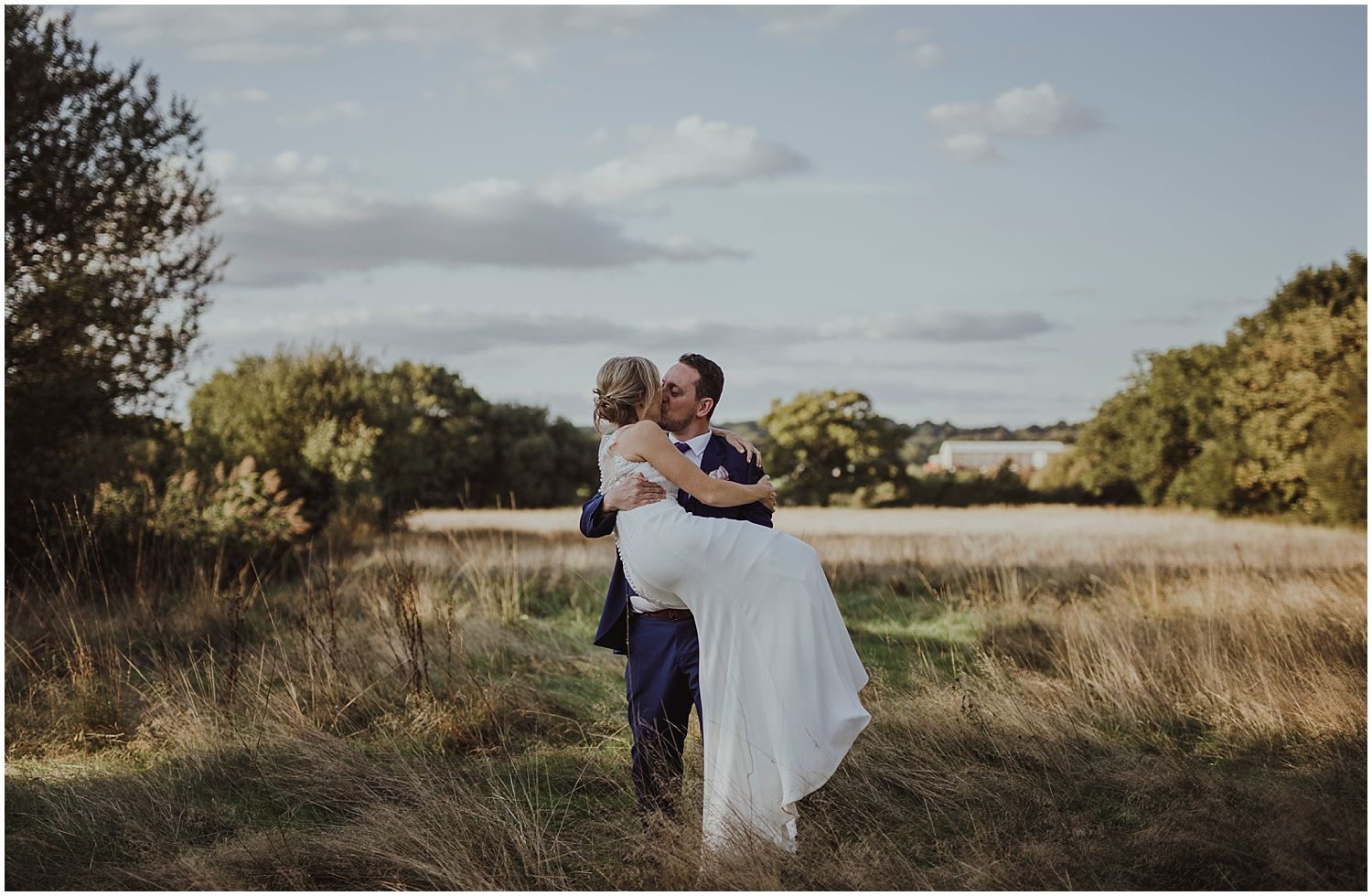Golden hour wedding photo at Smallfield Place