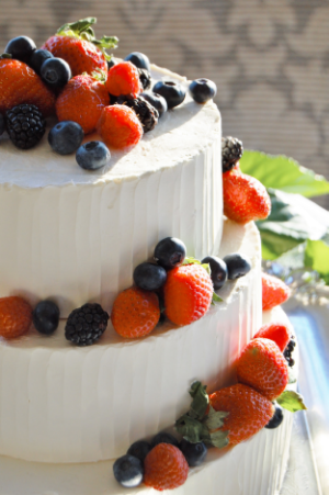 Vanilla Buttermilk Cake, Fresh Berry and Chantilly Cream Filling, Italian Buttercream Frost  Summer Berries accent this cake with a beautiful beveled edge.