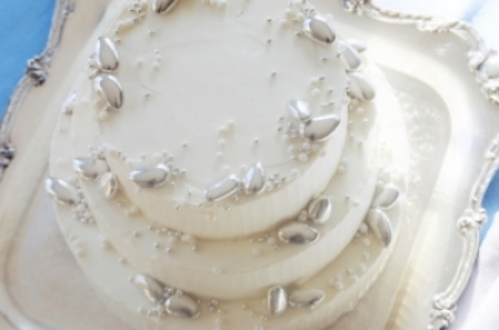 White Coconut Cake, Coconut Cream Filling, Italian Buttercream Frost  Silver Jordan Almonds, Dragees and Sugar Pearls are jewels on this simply sophisticated cake.