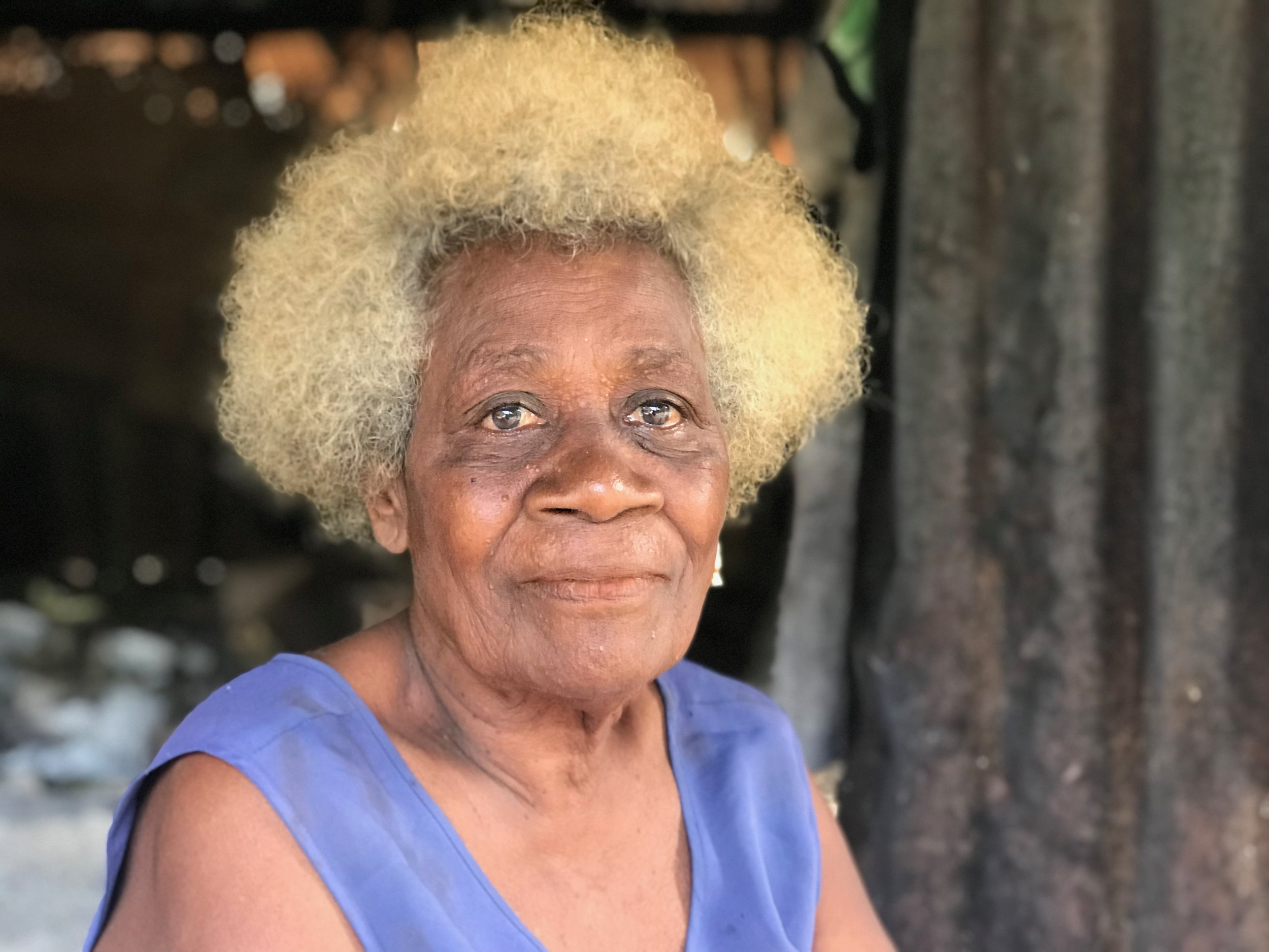 Serah is from the reef islands in Temotu. She's been trhough decades of ups and downs with her community, but she's anxious about the challenges they now face because of climate change.  She's hopeful that the chief will work to find solutions and relieved that the support from the government has improved quality of life so she can enjoy time with her family, instead of beig forced to relocate to higher ground.